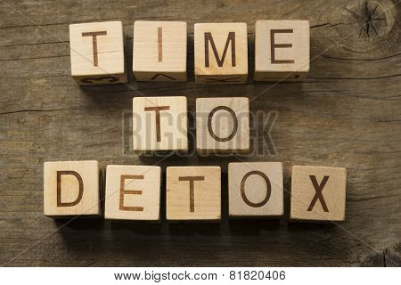 Time To Detox text on a wooden cubes on a wooden background
