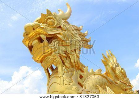 Golden dragon statue in Vietnam over blue sky