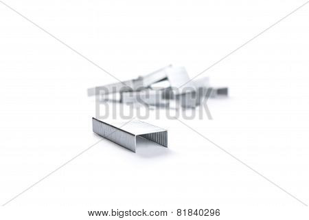 Stack Of Metal Staples. Isolated On A White.