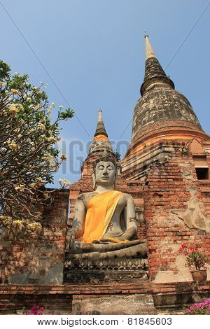 Buddha In Front Of Giant Pagoda At Watyaichaimongkol Temple