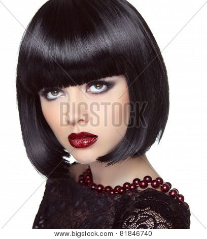 Black Short Bob Hairstyle. Fashion Brunette Girl Model With Makeup Looking Up. Haircut. Jewelry. Smo