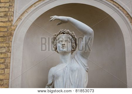 Statue In Facade Of Palace In Sans Souci