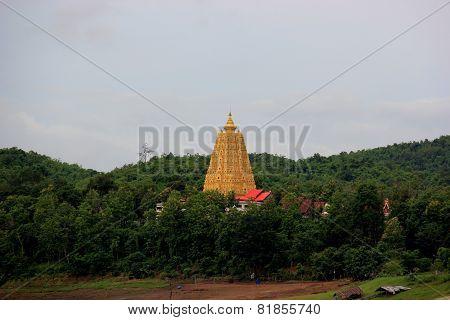 Chedi Buddhakhaya built to mimic the Mahabodhi stupa of Bodhgaya in India a symbol of Sangklaburi Kanchanaburi Thailand poster
