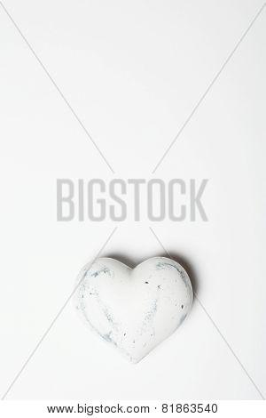 Wooden White Heart On White Paper