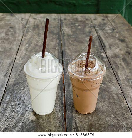 Ice Coffee With Milk Shake On Wood Table