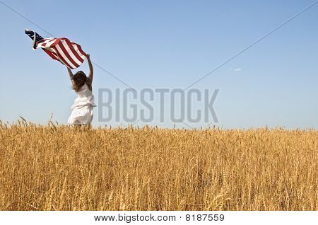 Beautiful young girl holding an American flag