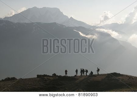 Trekking group has a rest in the sunset time in a mountain pass