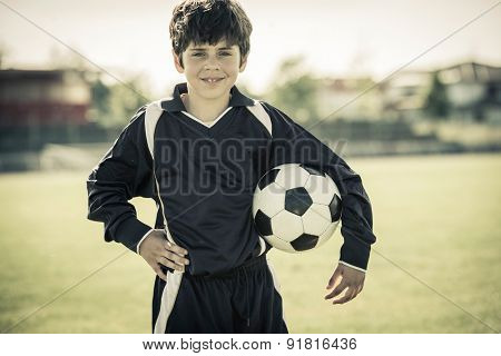 8 years old girl holding soccer ball