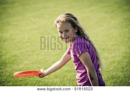 Cute girl playing with freesbi