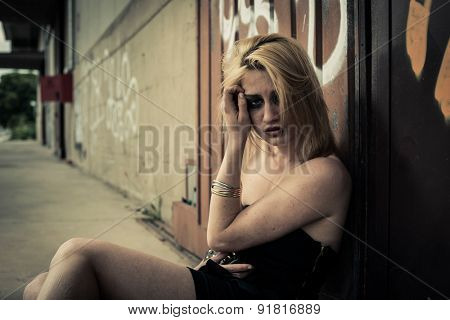 Scared/depressed young woman, maybe victim of violence or drugs