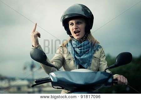 Angry girl on her scooter gesturing