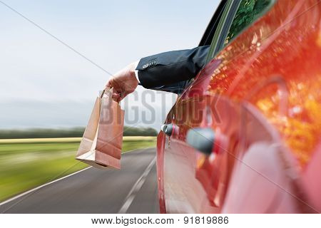Person Throwing Trash Out Of Car Window