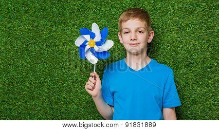 Portrait of smiling boy holding pinwheel
