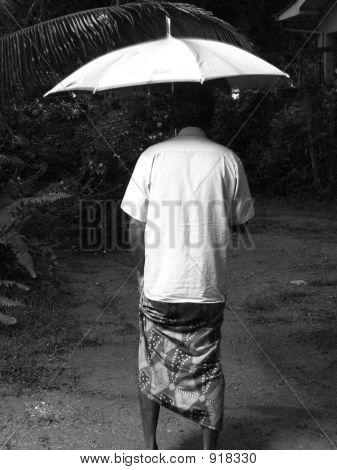 A Man Uner The Umbrella During The Rain