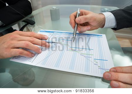 Two Businessmen Making Gantt Diagram
