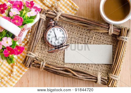 Vintage Paper Blank Tag And Clock With Fram And Flower On Wooden Background.