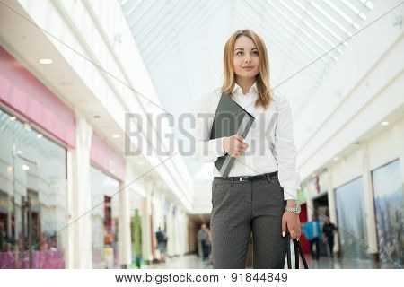 Young Office Woman With Document Folder