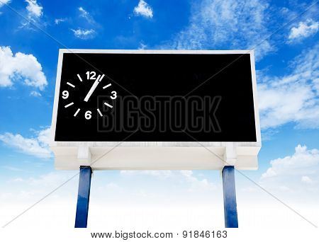 clock score board at football stadium with bluesky poster