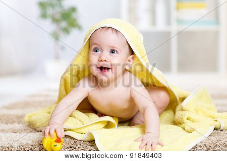 Cute Baby With A Towel After The Shower At Home
