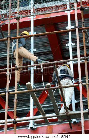 Two Builders On A Steel Scaffold