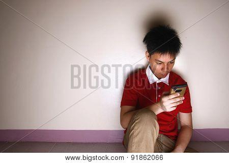 Teenage kid using a smartphone