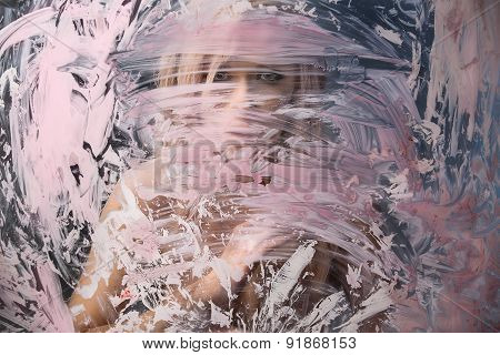 Portrait of seminude blonde through the glass smeared pink clay