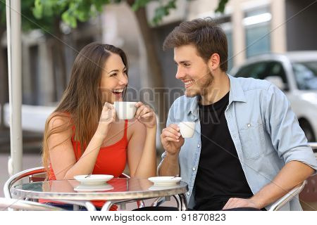 Couple Or Friends Talking And Drinking In A Restaurant