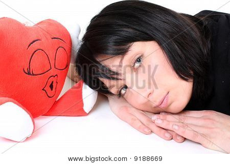 Smiling Girl In Black With Red Heart