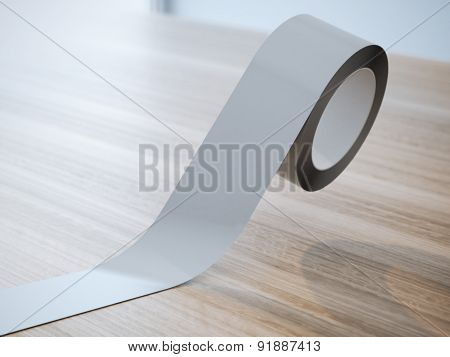 Gray insulating tape roll on the wooden table poster