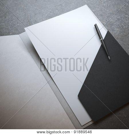 Black folder with pen