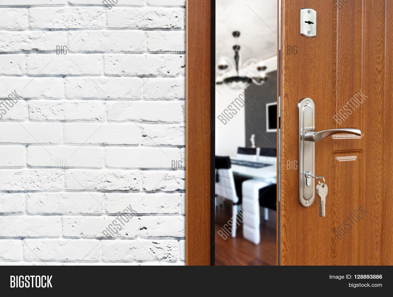 Half Opened Door To A Kitchen. Door Handle, Door Lock. Dining Room Door
