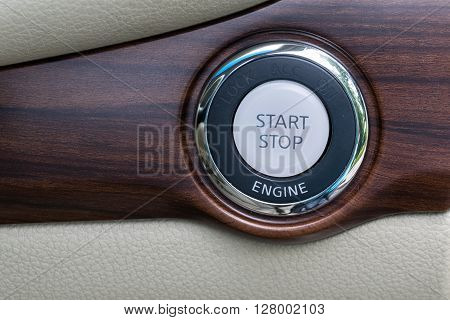 Engine start stop button from a modern car interior