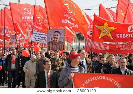 Orel Russia - May 1 2016: Communist party demonstration. People carrying red flags and Stalin's portrait horizontal