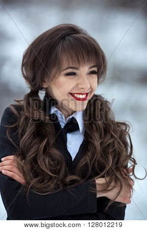 Very cute, happy, lucky, smiling, nice, attractive, lovely, friendly, kind, good, fashionable girl, student with stylish uniform, has good marks, well pass exams with flying colors, demonstrate good mood in winter.