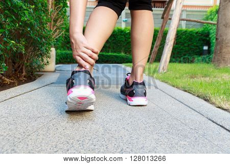 Ankle sprain while jogging or running concept