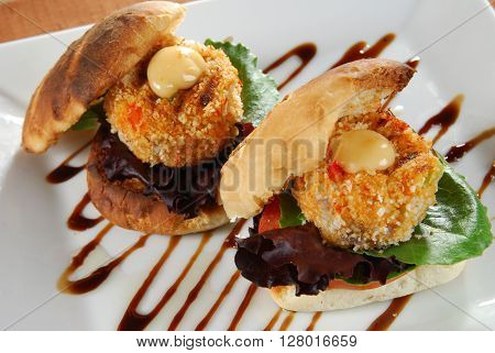 Overhead view of gourmet crab cake sandwiches