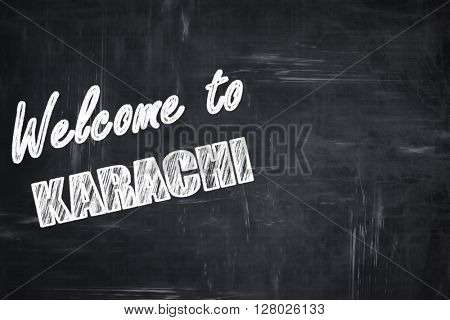 Chalkboard background with chalk letters: Welcome to karachi