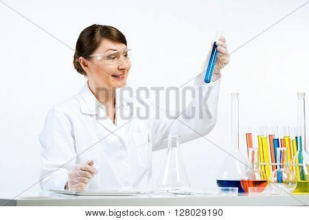 Attractive female scientist making tests in laboratory