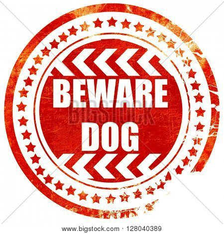 Beware of dog sign, grunge red rubber stamp on a solid white bac