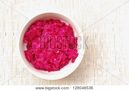 Sauerkraut And Red Beet In The Bawl On The White Background