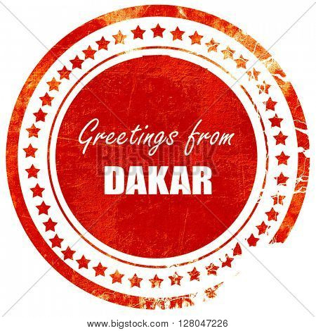 Greetings from dakar, grunge red rubber stamp  on a solid white background