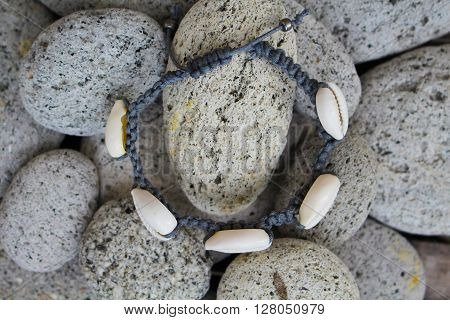 Cowrie shell bracelet with beach stones, cowrie shells and beach, natural shell jewelry, summer beach jewelry with the shells, white shells on grey stones, natural jewelry for boho style