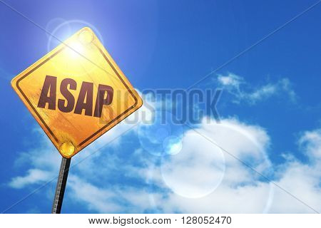 Yellow road sign with a blue sky and white clouds: asap