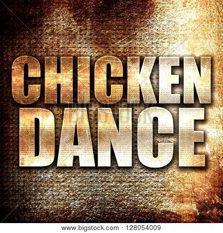 chicken dance, written on vintage metal texture