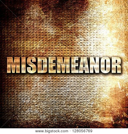 misdemeanor, written on vintage metal texture