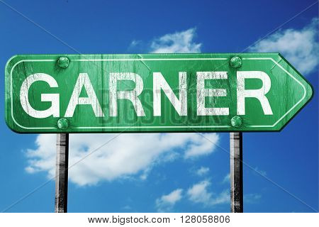 garner road sign , worn and damaged look