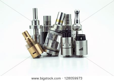 A collection of heads (tanks & drip tips) used for ecigarettes isolated on a white background.