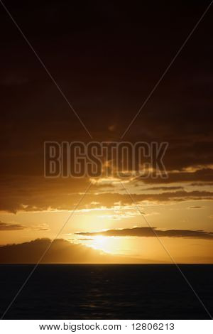 Sunset view of Pacific Ocean and Kihei island in Maui, Hawaii, USA.
