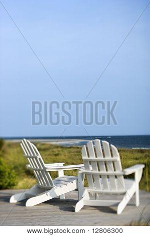 Adirondack chairs on deck looking towards beach on Bald Head Island, North Carolina.  *Web use