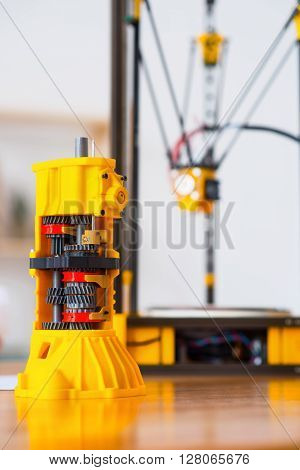 The child of new era.  Close up of model printed on 3d printer standing on the table
